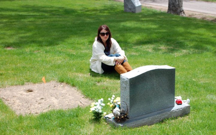 Sitting near Noah's grave on that second visit.